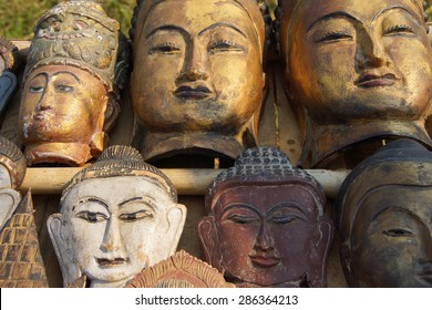 Carved wooden heads of Buddha,  at a weekly market on Inle Lake,  Myanmar (Burma)