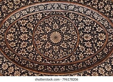 Carved, wooden, patterns.Eastern architectural decoration.