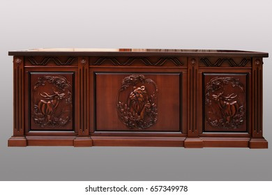 Carved wooden table on a gray background