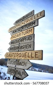 Carved Wooden Trail sign near Village Neunkirchen, Forrest of Odes, Hessen, Germany