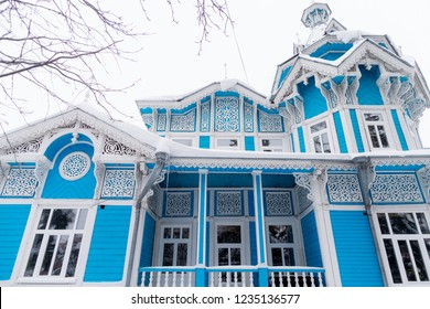 Carved wooden trim facade. Old historic house. Russian architecture. Chopped house with carved wooden architraves. Tomsk, Russia
