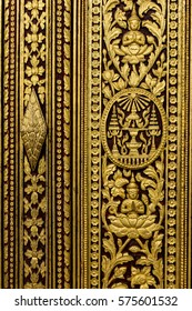 Carving Buddhism motifs in wood paint in gold and red color at Phnom Penh Royal Palace, Cambodia