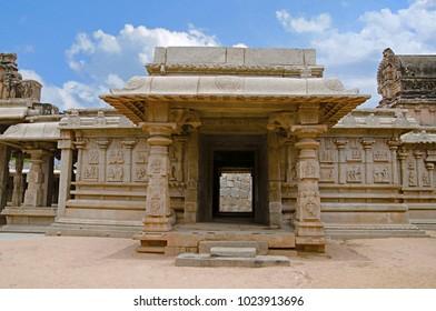 Carving details on the outer wall of Hazara Rama Temple. Hampi, Karnataka, India.