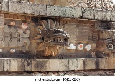 Carving details of Quetzalcoatl Pyramid at Teotihuacan Ruins - Mexico City.