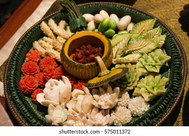 Carving fruits and vegetables. Eatable plate. Pumpkin plate. Thai food decoration.