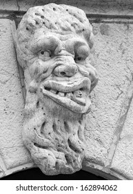Carving of a gargoyle adorns the wall of Santa Maria Formosa, Venice Italy
