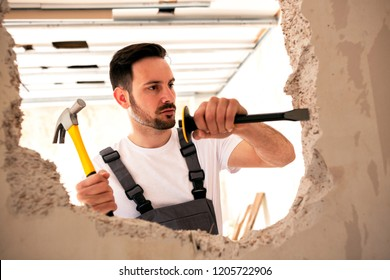 Carving a hole in the wall with pointed chisel and a hammer