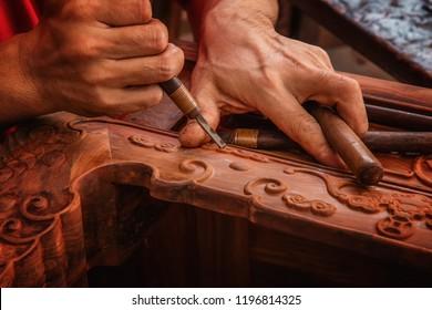 Carving and polishing of mahogany furniture