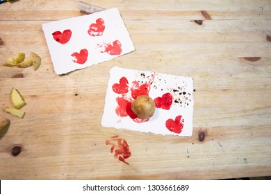 Carving potato. potatoes, colored ink, knives and paper on a wooden table to make stamps with potatoes. educational activity for children where they create a stamp by carving a potato