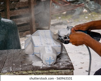 carving the stone with the angle grinder