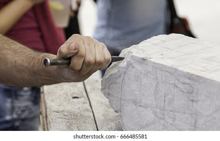 Carving stone, craftsman shaping stone, art and crafts