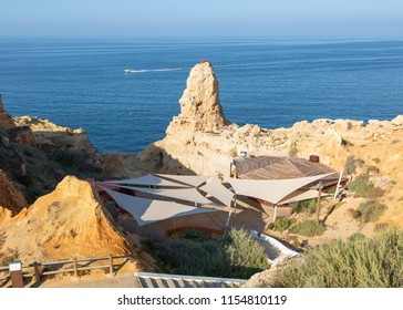 CARVOEIRO, PORTUGAL- July 26th, 2018: Boneca Bar and restaurant a popular barbecue restaurant set into the cliffs near Carvoeiro in Portugal