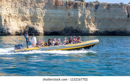 CARVOEIRO, PORTUGAL- July 27th, 2018: Fast rib boat taking tourists around the coast near Carvoeiro to visit the caves
