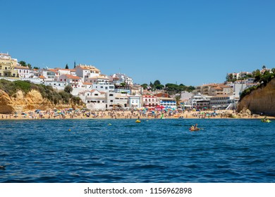 CARVOEIRO, PORTUGAL- July 27th, 2018: View of Carvoeiro beach and town taken from the sea