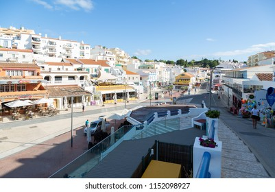 CARVOEIRO, PORTUGAL- July 29th, 2018: Early morning view of popular restaurants and bars in Carvoeiro town square.
