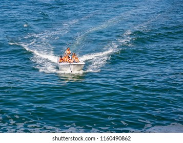CARVOEIRO, PORTUGAL- July 29th, 2018: Fast motor boat based in Carvoeiro taking tourists around the coast to visit the caves