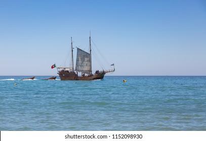 CARVOEIRO, PORTUGAL- July 30th, 2018: Santa Bernarda, a popular pirate boat from Portimao taking tourists around the coast