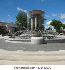 CARY, NC - MAY 2017: Fountain in a Park in Downtown with the Cary Arts Center in the Background
