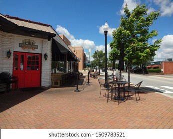 CARY, NC / USA - May 2017: Commercial Area of Historic Downtown Cary, North Carolina (Cafes, Theater, Shops)