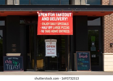 Cary, NC/United States- 04/04/2020: A small pizza parlor advertises it's takeout and delivery options amid the COVID-19 epidemic.