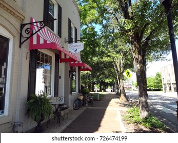 CARY, NORTH CAROLINA - MAY 2017: Shops line the sidewalks of downtown Cary, NC