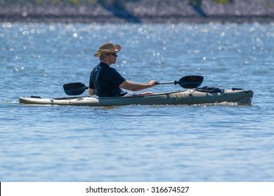 CARY, NORTH CAROLINA - SEPT 13: Retiree enjoying his kayak workout on 13 Sept 2015 at Lake Jordan