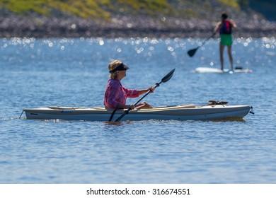 CARY, NORTH CAROLINA - SEPT 13: Retiree enjoying her kayak workout on 13 Sept 2015 at Lake Jordan