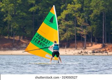 CARY, NORTH CAROLINA - SEPT 20: Retired man practicing whitewater kayak recoveries 20 Sept 2015 at Lake Jordan