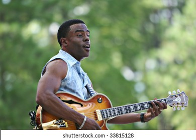 CARY, NORTH CAROLINA-AUGUST 27: Norman Brown performs on stage at Carolina Music Festival on August 27, 2006 in Cary, North Carolina.