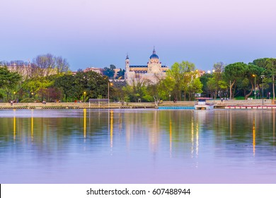 The Casa de Campo park in Madrid, Spain, is the biggest green area in the city. From the lake margins one has a beautiful of the Cathedral.