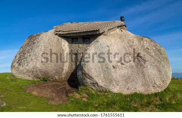 Casa do Penedo, a house built between huge rocks on top of a mountain in Fafe, Portugal. Commonly considered one of the strangest houses in the world.