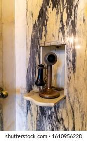 Casa Loma, Toronto, ON, Canada - Jan 4 2020 - Antique Toilet inside Casa Loma Castle,  vintage telephone