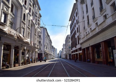 CASABLANCA, MOROCCO - 14 OCTOBER 2015: Unidentified people walk the arcades either side of tram tracks running through the streets of Casablanca