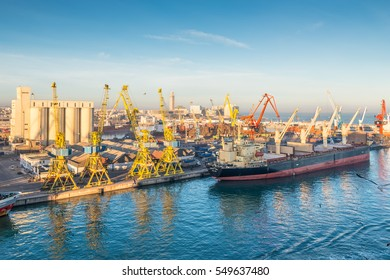Casablanca, Morocco - December 8, 2016: Cargo vessel Ocean Luck (Bulk Carrier) early in the morning in the seaport of Casablanca, Morocco. The scene with harbor cranes, elevators, ships and cargoes.