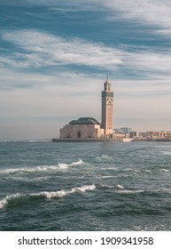 Casablanca, Morocco - January 25, 2021 - vertical view of Hassan II Mosque, the largest mosque in Africa with waves on the Atlantic Ocean
