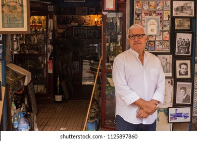 Casablanca, Morocco- JUL 1 2018 An old shopkeeper displaying his collectibles in Central Market of Casablanca, Morocco