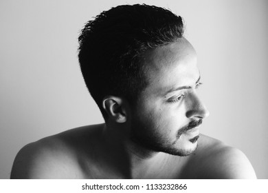 Casablanca, Morocco, July 08 2018 : Black and white Portrait of a Young muslim man with bearded face and simple hair .