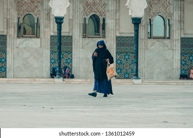 Casablanca, Morocco - March 30 2019 : A muslim woman, in traditional hijab dressed niqab and hijab ,muslim women for salat