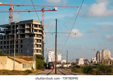Casablanca, Morocco - May 05, 2017 : tram on railway and buildings in a construction site against sky