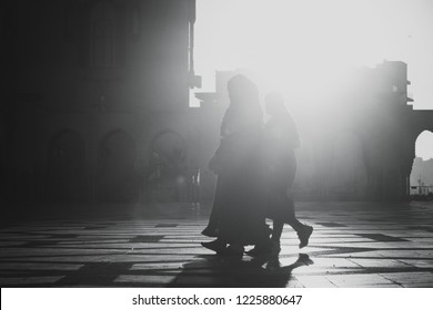 Casablanca, Morocco - November 06 2018 ; Silhouette of people walking beside the hassan ll mosque with a black and white effect