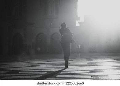 Casablanca, Morocco - November 06 2018 : Silhouette of a moroccan girl walking beside the hassan ll mosque with a black and white effect