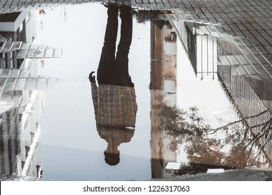 Casablanca, Morocco - November 06 2018 : Man reflection in water