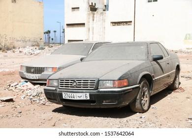 Casablanca, Morocco - September 29, 2019: Abandoned luxury cars Cadillac Eldorado and Cadillac Seville in the city street.