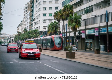 Casablanca, Morocco - September 3, 2017 : street car passing on railways near old buildings and taxis