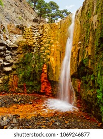 Cascada de Colores - Picturesque dam for rainwater in a volcanic crater, which was colorfully colored by mineral water, water in long exposure - Location: Spain, Canary Islands, La Palma