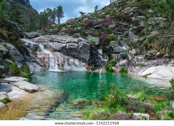 Cascada Poco Azul - waterfall on a mountain stream - azure lake - spring in the Peneda-Geres National Park - Portugal