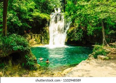 Cascadas de Tamasopo, San Luis Potosi, Mexico. Some tourist having a fresh bath in the middle of the nature.