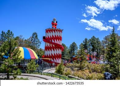 Cascade, Colorado, USA - 5/2019: North Pole Santa's Workshop view of the rides.  A Christmas themed amusement park.