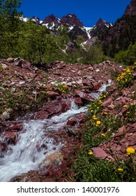 Cascade flowing from mountains in the Maroon Bells Wilderness, Aspen, Colorado