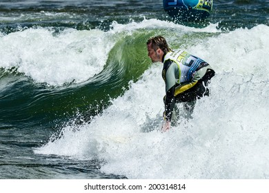 CASCADE, IDAHO/USA - JUNE 21, 2014: number 24 rides a wave during the PAyette River Games